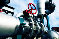 Industrial zone, Steel pipelines and valves Royalty Free Stock Photos