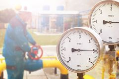 Pressure gauge in oil and gas production process for monitor condition. Industrial zone steel pipelines and valves gas or oil line Royalty Free Stock Photography