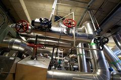 Industrial zone, Steel pipelines, valves and pumps Royalty Free Stock Images