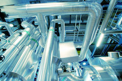 Industrial zone, Steel pipelines, valves and pumps Stock Photos