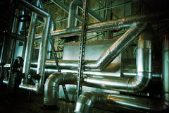 Industrial zone, Steel pipelines, valves and tanks Royalty Free Stock Image
