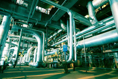 Industrial zone, Steel pipelines, valves and tanks Stock Image