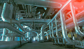 Industrial zone, Steel pipelines, valves and tanks Royalty Free Stock Images