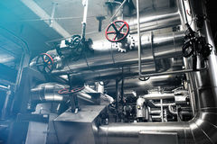 Industrial zone, Steel pipelines, valves and tanks Royalty Free Stock Photos