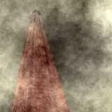 Industrialization Concept. A tall brick chimney is seen through billowing smoke and pollution Royalty Free Stock Photos