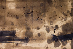 Industrially polluted surface. Industrial pollution background consisting of oil stains and paints on thick paper royalty free stock images