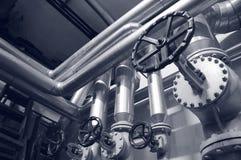 Industriegas- und -schmierölrohre Stockfotos