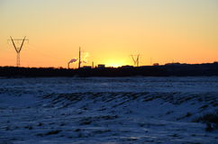 Industriell vintersolnedgång royaltyfri bild