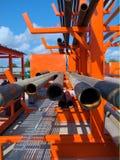 Industriella stålrörrör på en lagring rack Royaltyfria Bilder