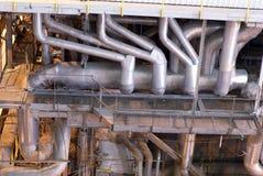 Industrielle Becken und Rohre Stockfotos