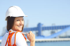 Industrieller Hintergrund der weiblichen Arbeitskraft Stockfotos