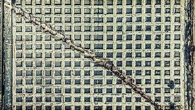 Industrieller Hintergrund oder Beschaffenheit des Schmutzes gemacht von der alten Luke Stockbilder