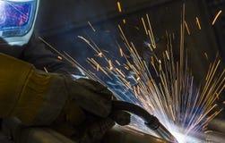 Industrieller Stahlschweißer in der Fabrik technisch, Stockfotografie