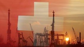 Industrielles Konzept mit die Schweiz-Flagge bei Sonnenuntergang stock footage