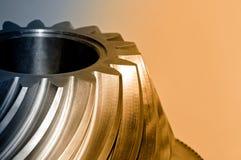 Industriellt koniskt kugghjul, kugghjul Brunt tonad bild royaltyfri bild