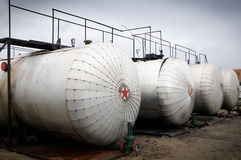 Industries of oil refining and gas,. Industries of oil refining and gas-oil storage tanks Royalty Free Stock Image