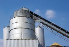 Industries, silo and concrete mixer stock photo