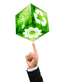 Industries symbols on businessman Fingertip. Gears image , recycle sign and bulb light image cube on businessman Fingertip stock images