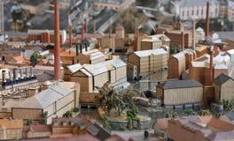 Industriestadtminiaturbaumuster Stockfotos