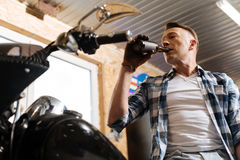 Industrious skillful man relaxing in his workshop Stock Photo