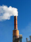 Industry. White smoke and blue sky Royalty Free Stock Photography