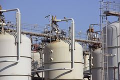 Industry. A detail of chemical industry with oil storage tanks Stock Image
