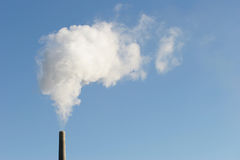 Industry. Industrial chimney with smoke, horizontal version with copyspace Stock Photo