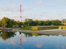 Industry. A factory chimney near water in Klaipeda, Lithuania Stock Photo