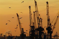 Industry. Cranes in Hamburg harbor, germany Stock Image