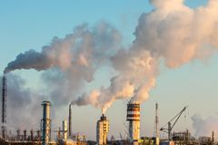 Industry air pollution. Massive smoke coming out of factory. Air pollution industry royalty free stock photography