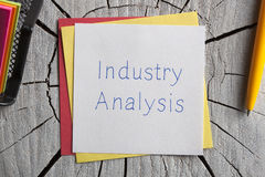 Industry Analysis written on a note Stock Photography