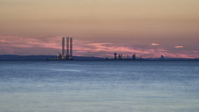 Industry area - Port of Gdansk at sunset, Poland Stock Images