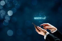 Industry 4.0 concept. Industry 4.0 - automation, robotics and data exchange in manufacturing technologies. Smart factory concept stock images