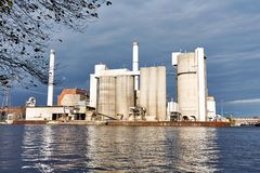 Industry - Cement Factory - Across a River - Cloudy Autumn Afternoon. A cement factory across a river, on a cloudy autumn afternoon in Berlin Royalty Free Stock Photography
