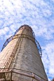 Industry chimney. In a blue sky on sunny day Stock Image