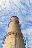 Industry chimney. In a blue sky on sunny day Royalty Free Stock Photo