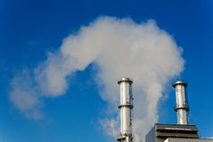 Industry chimney with exhaust gases Royalty Free Stock Photography