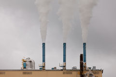 Industry chimneys polluting warming atmosphere Stock Images