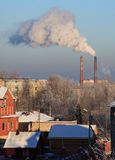 Industry chimneys smoking. Winter view of industry chimneys smoking Royalty Free Stock Images