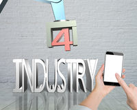 Industry 4.0 concept, hand using smartphone controlling robot ar Royalty Free Stock Photos
