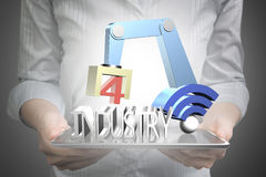 Industry 4.0 concept, hand using tablet controlling robot arm Stock Photo