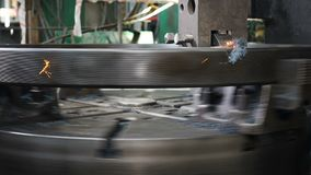 Industry concept. Machining process in factory for bearing production. Metal working lathe in factory. Modern bearings