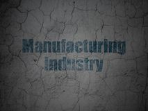 Industry concept: Manufacturing Industry on grunge wall background. Industry concept: Blue Manufacturing Industry on grunge textured concrete wall background stock illustration