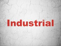 Industry concept: Industrial on wall background. Industry concept: Red Industrial on textured concrete wall background royalty free illustration