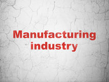 Industry concept: Manufacturing Industry on wall background. Industry concept: Red Manufacturing Industry on textured concrete wall background stock illustration