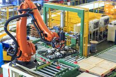 Industry 4.0 concept, Robot picking for smart warehouse in production line manufacturer factory. Industrial robot is picking product and place into pallet for stock images