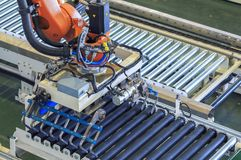 Industry 4.0 concept, Robot picking  for  smart warehouse in production line manufacturer factory Stock Photo
