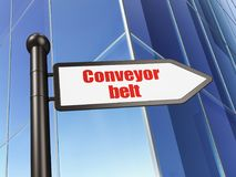 Industry concept: sign Conveyor Belt on Building background Royalty Free Stock Images