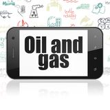 Industry concept: Smartphone with Oil and Gas on display Royalty Free Stock Image