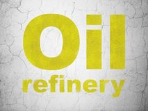 Industry concept: Oil Refinery on wall background. Industry concept: Yellow Oil Refinery on textured concrete wall background stock illustration